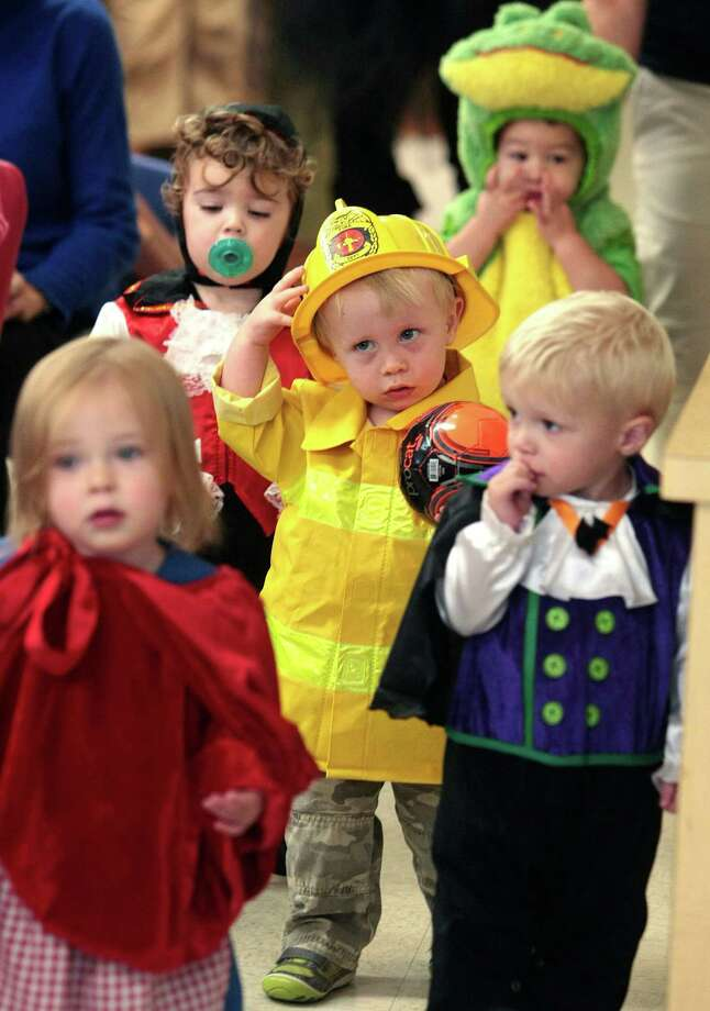 Noah Cole, dressed as a firefighter, walks in the parade of costumes Thursday October 31, 2013 at Primrose School of College Park in The Woodlands, Tx. Photo: Billy Smith II, Chronicle / © 2013 Houston Chronicle