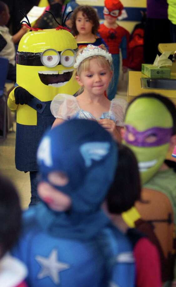 Kids participate in the Parade of Costumes at Primrose School of College Park in The Woodlands, Tx. Photo: Billy Smith II, Chronicle / © 2013 Houston Chronicle