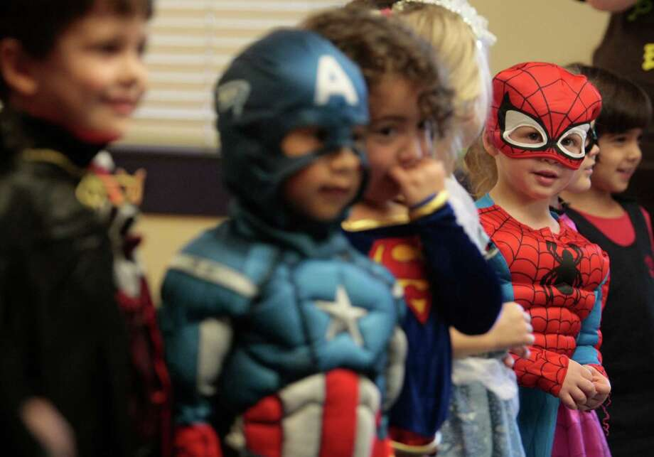 Andrew David, dressed as Spiderman, sings with classmates Thursday October 31, 2013 during the Parade of Costumes at Primrose School of College Park in The Woodlands, Tx. T Photo: Billy Smith II, Chronicle / © 2013 Houston Chronicle