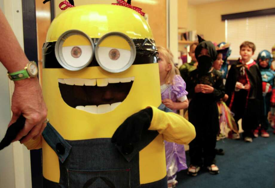 Ella Hagemann, dressed as Minon from the movie Despicable Me, walks in the parade of costumes. Photo: Billy Smith II, Chronicle / © 2013 Houston Chronicle