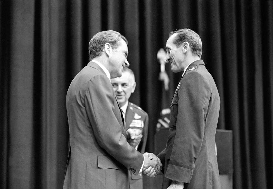 President Richard Nixon shakes hands with U.S. Army Col. Robinson Risner after he welcomed a group of former POWs to Washington in 1973. Robinson was one of the highest-profile POWs held in North Vietnam. Photo: Harvey Georges, STF / 1973 AP