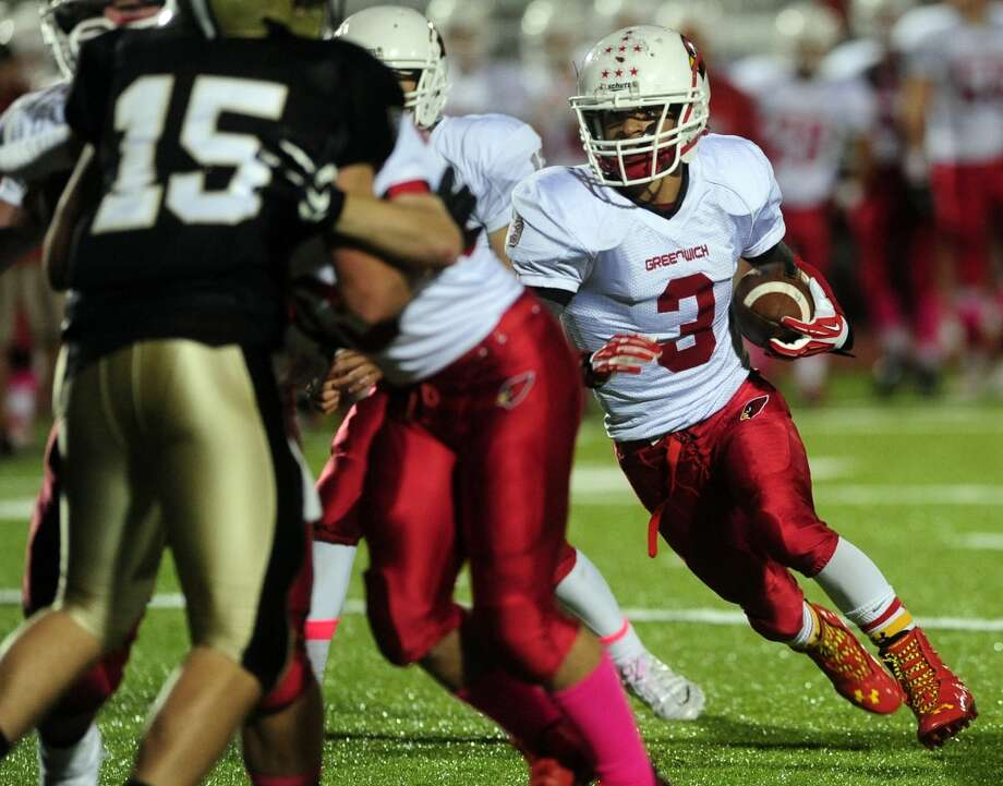 Greenwich's Austin Longi carries the ball, during football action against Trumbull in Trumbull, Conn. on Friday October 18, 2013. Photo: Christian Abraham