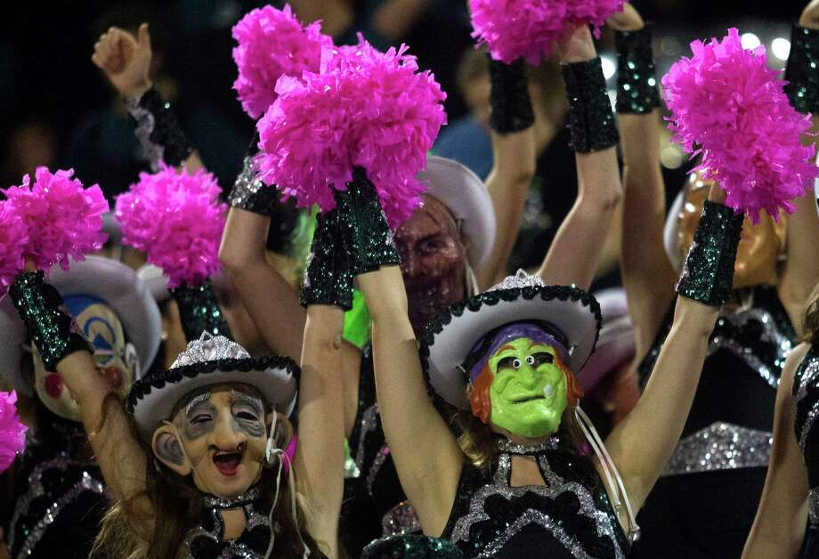 Members of the Clear Falls Emeralds wear their scary Halloween masks as they cheer during a high school football game against Clear Lake at CCISD Veterans Stadium on Thursday, Oct. 31, 2013, in League City. Photo: J. Patric Schneider, For The Chronicle / © 2013 Houston Chronicle