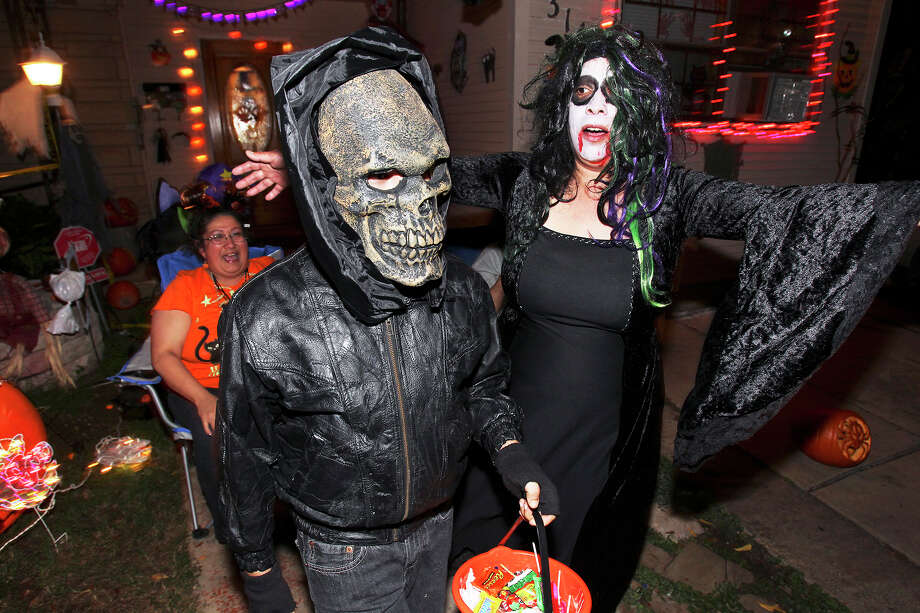 "Joshua Compeon has his bluff called by Angel Cortez who frightens him back with her act as Llorona the ""Crying Lady"" as kids go trick-or-treating on the Southeast Side on October 31, 2013. Behind is Cindy Castillo. Photo: TOM REEL"