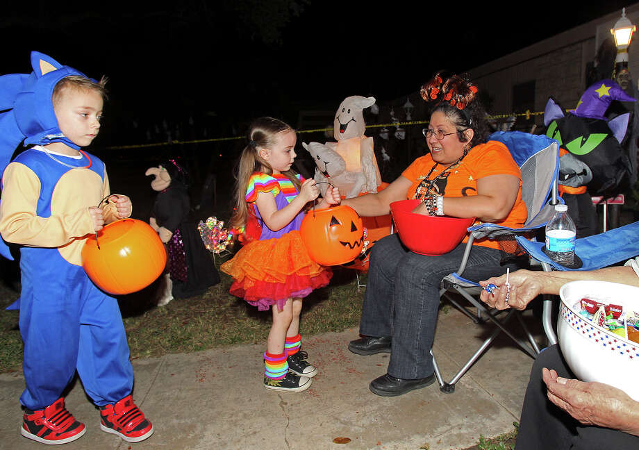 Cindy Castillo hands out candy as kids go trick-or-treating on the Southeast Side  on October 31, 2013. Photo: TOM REEL