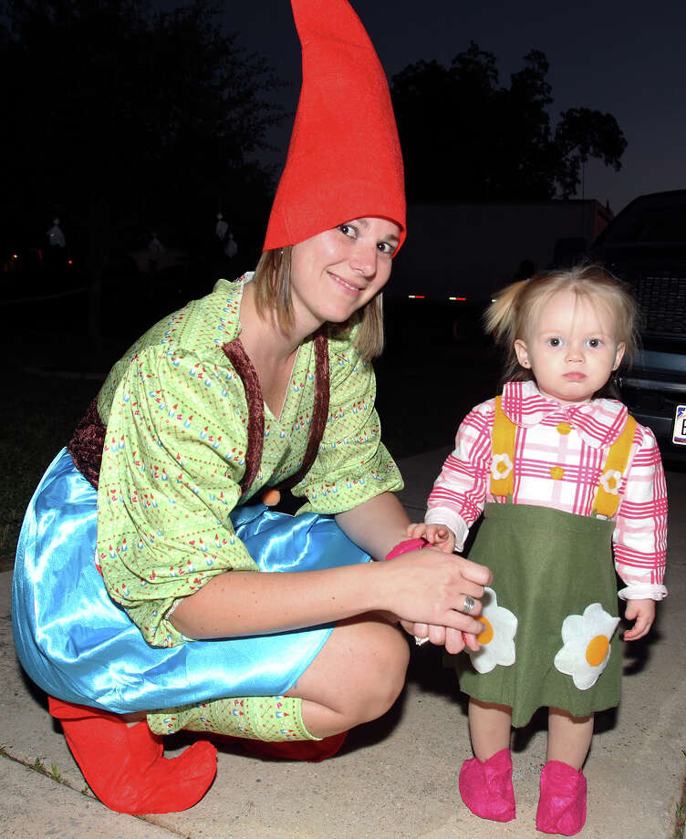 Heather Jurek enjoys the evening with daughter Addison as kids go trick-or-treating on the Southeast Side  on October 31, 2013. Photo: TOM REEL