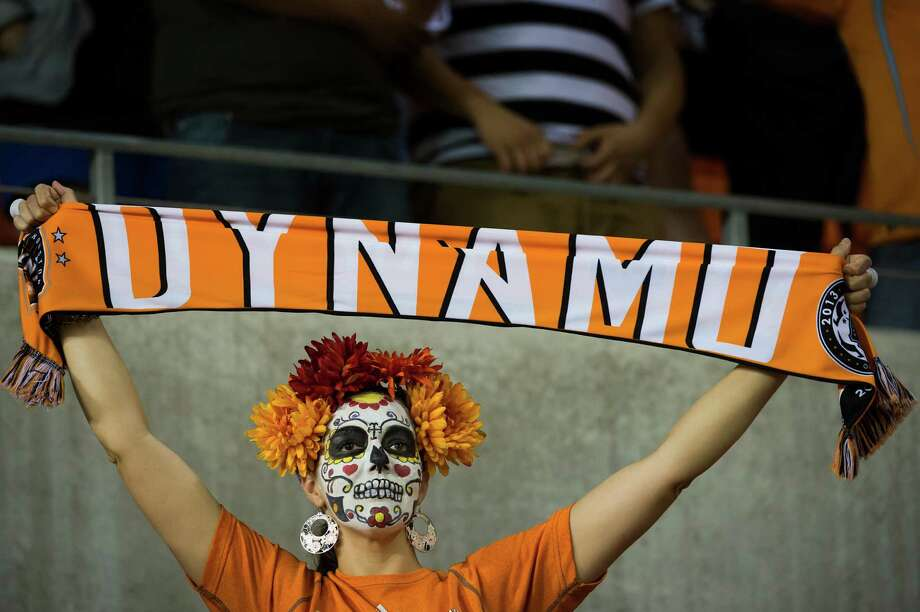 Houston Dynamo fans cheer as their team takes the field on Halloween night for a MLS playoff soccer match against the Montreal Impact on Thursday, Oct. 31, 2013, at BBVA Compass Stadium in Houston. Photo: Smiley N. Pool, Houston Chronicle / © 2013  Houston Chronicle