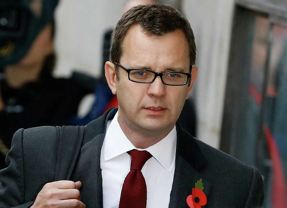 Andy Coulson arrives at The Old Bailey law court in London, Thursday, Oct. 31, 2013. Former News of the World national newspaper editors Rebekah Brooks and Andy Coulson went on trial Monday, along with several others, on charges relating to the hacking of phones and bribing officials while they were employed at the now closed tabloid paper. (AP Photo/Kirsty Wigglesworth) Photo: Kirsty Wigglesworth, STF / AP