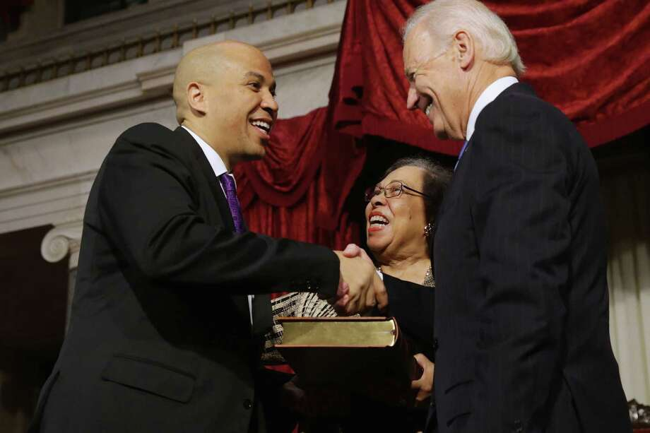 Vice President Joe Biden (right) congratulates Sen. Cory Booker and his mother Thursday at the U.S. Capitol. Photo: Chip Somodevilla / Getty Images