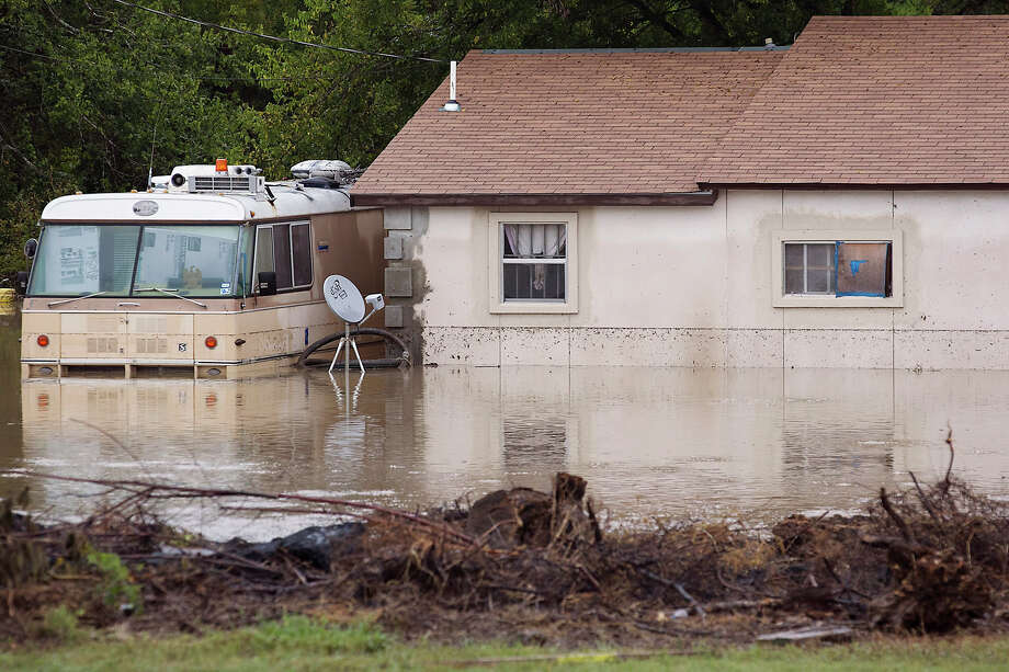 This photo shows a home on Bluff Springs Road submerged in Austin, Texas, on Thursday, Oct. 31, 2013. Heavy overnight rains brought flooding to the area. Photo: Ralph Barrera, STATESMAN.COM / STATESMAN.COM