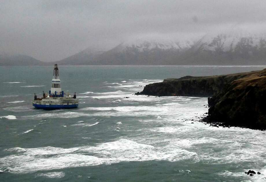 The Shell drilling rig Kulluk sits grounded off a small island near Kodiak Island in January after it was towed through an intense storm. Shell is likely to scrap the conical drilling unit, which worked in the Beaufort Sea last year. Photo: Travis Marsh, HOPD / U.S. Coast Guard