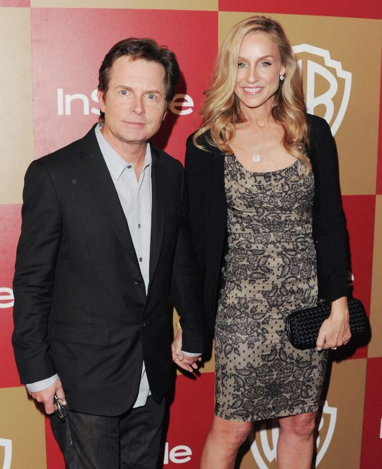 "Actor Michael J. Fox and Tracy Pollan met while filming the '80s sitcom ""Family Ties."" They married in 1988. Photo: Jon Kopaloff, FilmMagic / 2013 Jon Kopaloff"