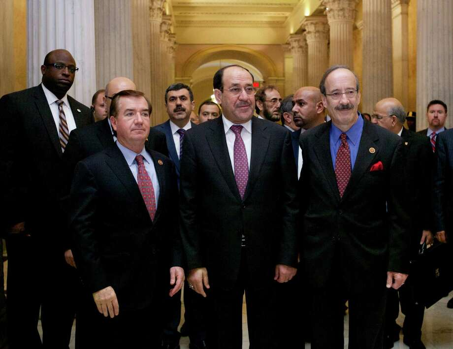 Iraqi Prime Minister Nouri al-Maliki (center) walks with the House Foreign Affairs Committee ranking Democrat Rep. Eliot Engel (right), D-N.Y., and the committee's chairman Rep. Ed Royce, R-Calif., before their meeting Wednesday in Washington. Photo: Molly Riley / Associated Press