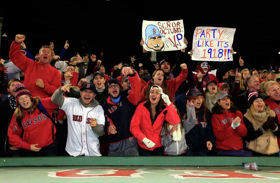 BOSTON, MA - OCTOBER 30:  Fans react after the Boston Red Sox defeated the St. Louis Cardinals 6-1 in Game Six of the 2013 World Series at Fenway Park on October 30, 2013 in Boston, Massachusetts.  (Photo by Jamie Squire/Getty Images) ORG XMIT: 185688241 Photo: Jamie Squire / 2013 Getty Images