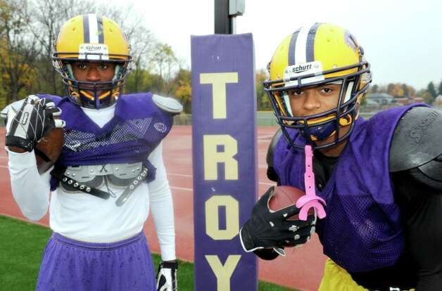 Troy High School football running backs Rayshawn Johnson, left, and Maurice Jones on Thursday Oct. 31, 2013 in Troy, N.Y. (Michael P. Farrell/Times Union) Photo: Michael P. Farrell / 00024467A