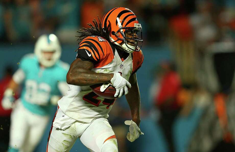 MIAMI GARDENS, FL - OCTOBER 31:  Adam Jones #24 of the Cincinnati Bengals recovers a fumble during a game against the Miami Dolphins at Sun Life Stadium on October 31, 2013 in Miami Gardens, Florida.  (Photo by Mike Ehrmann/Getty Images) ORG XMIT: 179693113 Photo: Mike Ehrmann / 2013 Getty Images