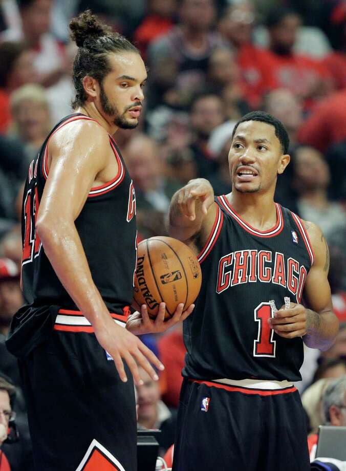 Chicago Bulls guard Derrick Rose, right, talks with center Joakim Noah during the first half of an NBA basketball game against the New York Knicks in Chicago, Thursday, Oct. 31, 2013. (AP Photo/Nam Y. Huh) ORG XMIT: CXA113 Photo: Nam Y. Huh / AP