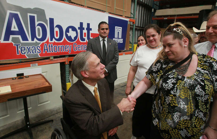 "Attorney General Greg Abbott greets Vivian Brown at Steves & Sons in San Antonio. Abbott said that ""to unleash the power of entrepreneurs and innovators, government must be limited."" Photo: John Davenport / San Antonio Express-News"