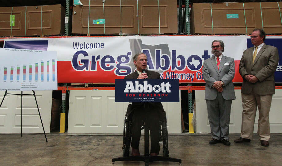 "Abbott has several proposals to promote business that are part of his ""Work Texas"" initiative. At right are Steves & Sons CEO Edward Steves and company President Sam Bell Steves III. Photo: SAN ANTONIO EXPRESS-NEWS / ©San Antonio Express-News/Photo may be sold to the public"