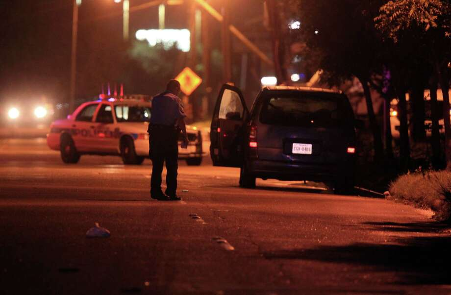 HPD investigates after a child is fatally struck by a vehicle in southwest Houston on Halloween. Photo: Mayra Beltran, Houston Chronicle / © 2013 Houston Chronicle