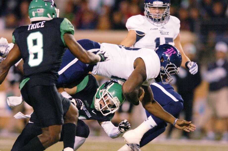 Oct. 31: North Texas 28, Rice 16Record: 6-3North Texas defensive back Kenny Buyers upends Rice senior running back Charles Ross. Photo: David Minton, Associated Press