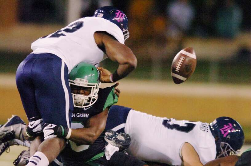 North Texas defensive back Marcus Trice (8) causes a fumble by Rice running back Charles Ross.
