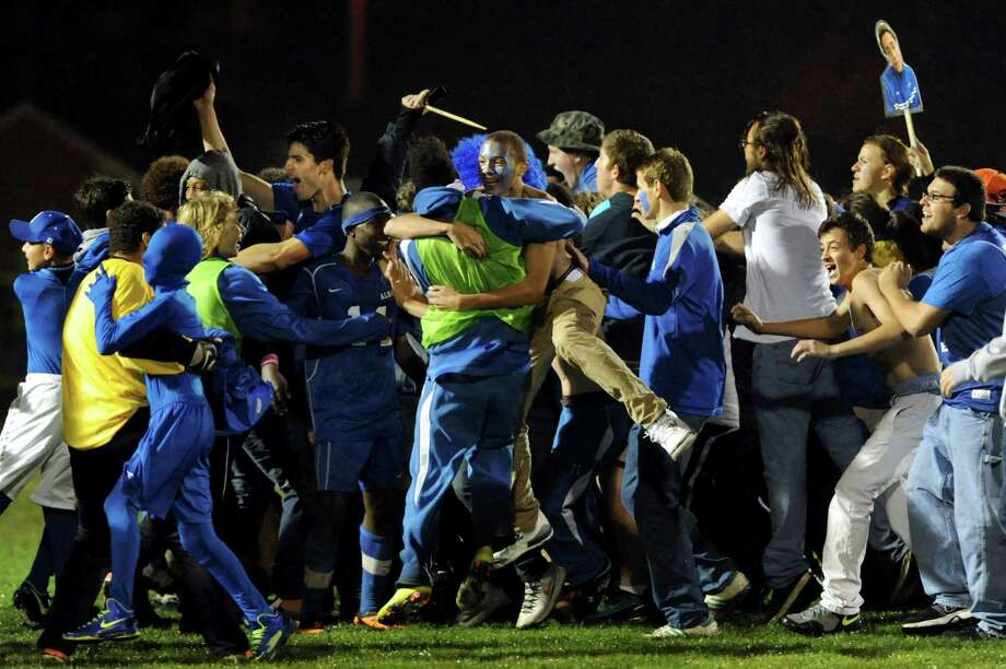 Albany fans run onto the field when they win 2-1 in the Section II Class AA soccer semifinal over Shenendehowa on Thursday, Oct. 31, 2013, at Colonie High in Colonie, N.Y. (Cindy Schultz / Times Union) Photo: Cindy Schultz / 00024412A