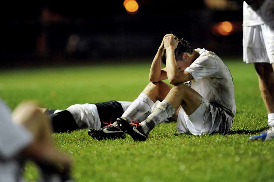 Shenendehowa's James Homan and teammates react to their loss to Albany in the Section II Class AA soccer semifinal on Thursday, Oct. 31, 2013, at Colonie High in Colonie, N.Y. (Cindy Schultz / Times Union) Photo: Cindy Schultz / 00024412A