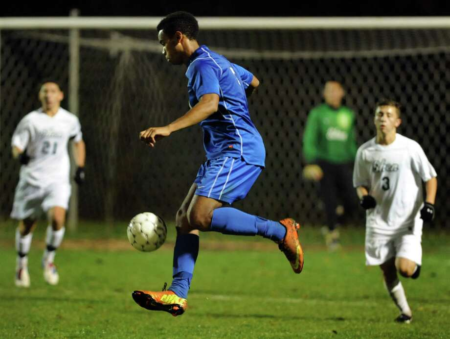 Albany's Khalis Holtzclaw, center, controls the ball during their Section II Class AA soccer semifinal against Shenendehowa on Thursday, Oct. 31, 2013, at Colonie High in Colonie, N.Y. (Cindy Schultz / Times Union) Photo: Cindy Schultz / 00024412A