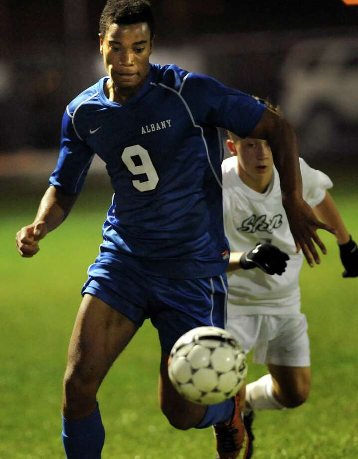 Albany's Khalis Holtzclaw, left, controls the ball during their Section II Class AA soccer semifinal against Shenendehowa on Thursday, Oct. 31, 2013, at Colonie High in Colonie, N.Y. (Cindy Schultz / Times Union) Photo: Cindy Schultz / 00024412A