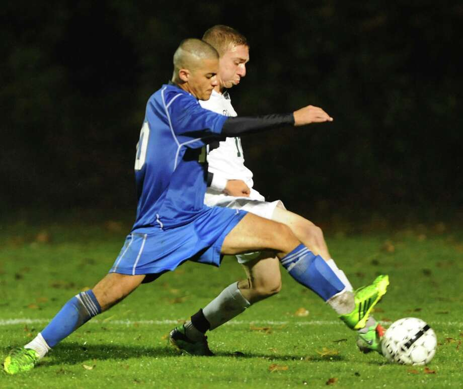 Albany's Ali Alalkawi, left, and Shenendehowa's Anthony Romeo battle for the ball during their Section II Class AA soccer semifinal on Thursday, Oct. 31, 2013, at Colonie High in Colonie, N.Y. (Cindy Schultz / Times Union) Photo: Cindy Schultz / 00024412A