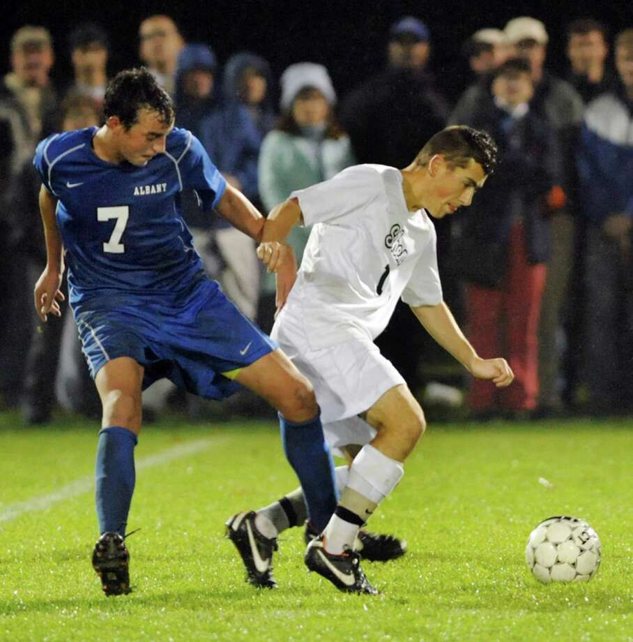 Albany's Erick Kwizera, left, and Shenendehowa's Nick Martin battle for the ball during their Section II Class AA soccer semifinal on Thursday, Oct. 31, 2013, at Colonie High in Colonie, N.Y. (Cindy Schultz / Times Union) Photo: Cindy Schultz / 00024412A