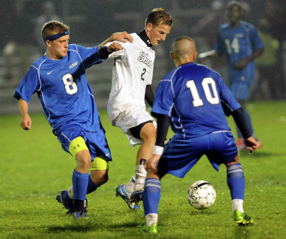 Shenendehowa's Danny Juers, center, controls the ball a Albany's Denis Leon, left,and Ali Alalkawi during their Section II Class AA soccer semifinal on Thursday, Oct. 31, 2013, at Colonie High in Colonie, N.Y. (Cindy Schultz / Times Union) Photo: Cindy Schultz / 00024412A