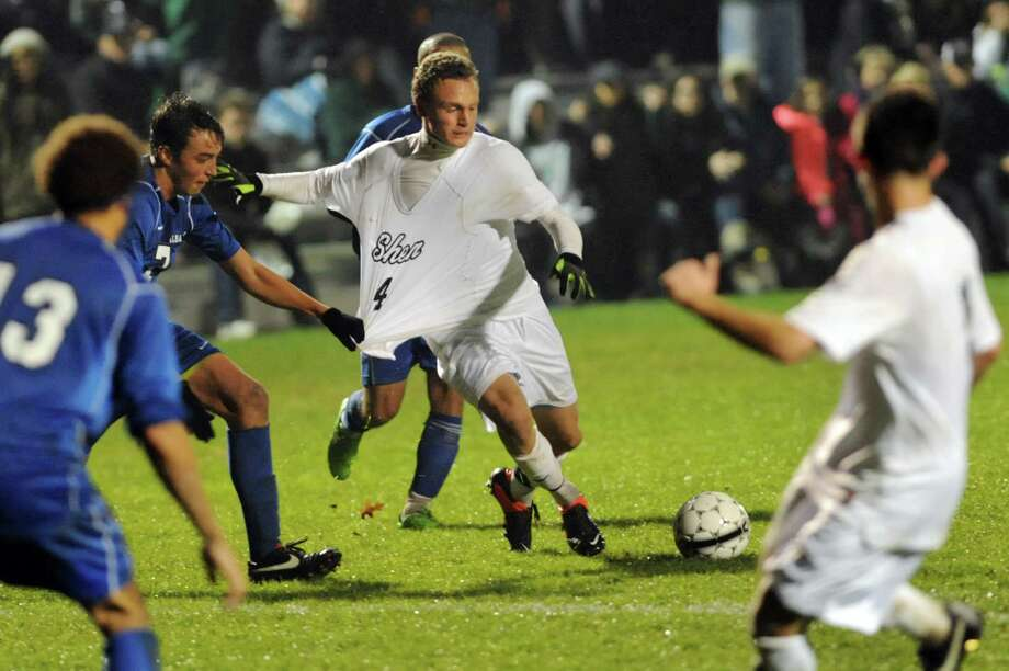 Shenendehowa's Tucker Marvin, center, works the ball during their Section II Class AA soccer semifinal against Albany on Thursday, Oct. 31, 2013, at Colonie High in Colonie, N.Y. (Cindy Schultz / Times Union) Photo: Cindy Schultz / 00024412A