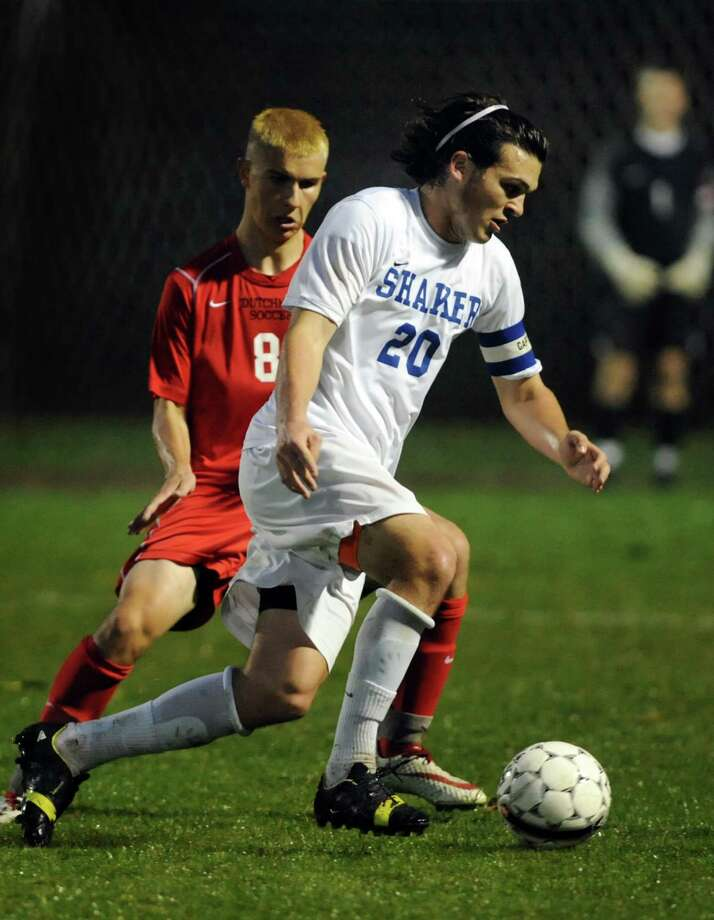Shaker's David Riccio, right, controls the ball as Guilderland's Noah Scott defends during their Section II Class AA soccer semifinal on Thursday, Oct. 31, 2013, at Colonie High in Colonie, N.Y. (Cindy Schultz / Times Union) Photo: Cindy Schultz / 00024412A