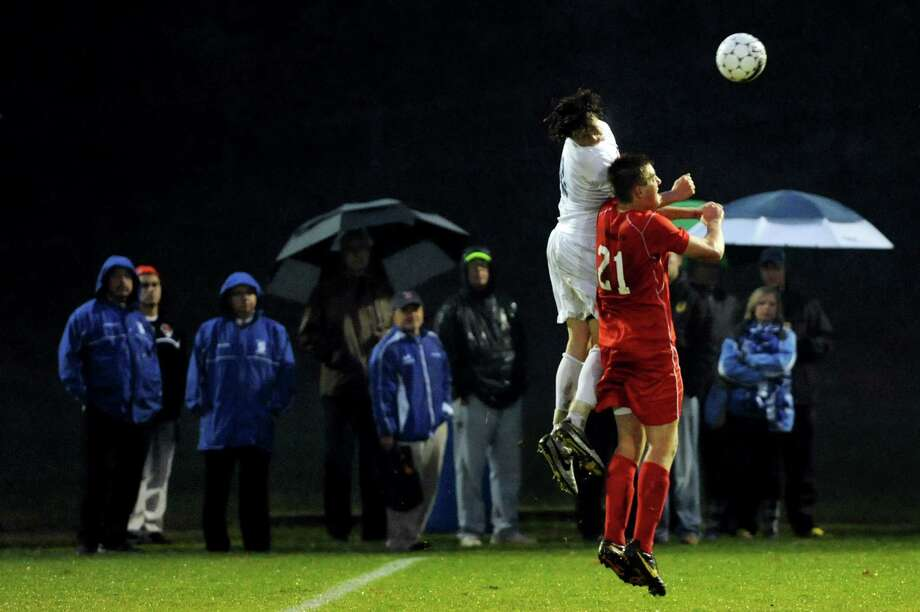 Shaker's Brett Gaughan, left, and Guilderland's Jack Hanlon go up for the header during their Section II Class AA soccer semifinal against Shaker on Thursday, Oct. 31, 2013, at Colonie High in Colonie, N.Y. (Cindy Schultz / Times Union) Photo: Cindy Schultz / 00024412A