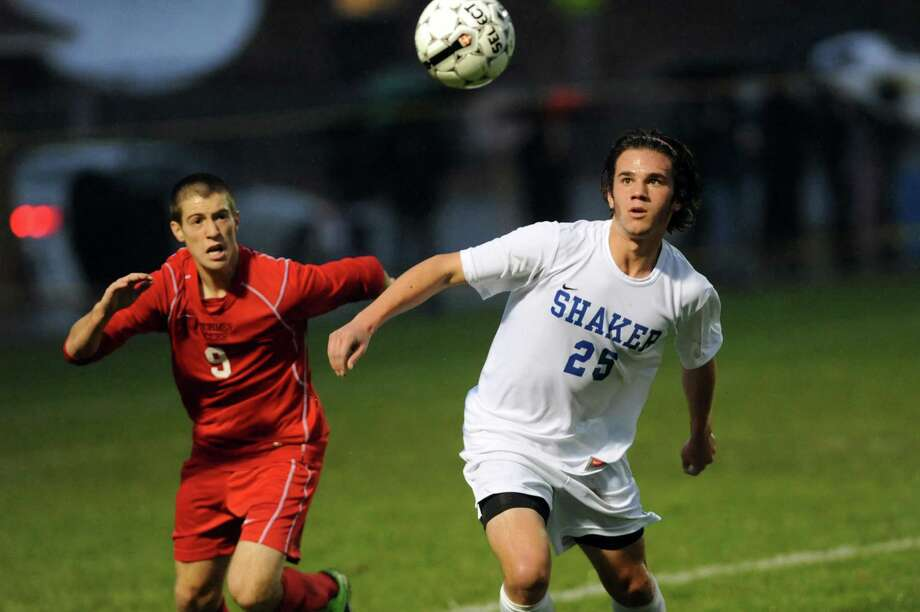 Guilderland's Connor Rubin, left, and Greg Milnarik go after a loose ball during their Section II Class AA soccer semifinal against Shaker on Thursday, Oct. 31, 2013, at Colonie High in Colonie, N.Y. (Cindy Schultz / Times Union) Photo: Cindy Schultz / 00024412A