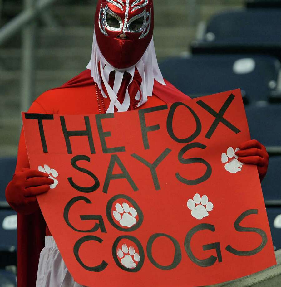 A University of Houston fan holds a sign during the college football game between Houston Cougars and the South Florida Bulls at Reliant Stadium Thursday, Oct. 31, 2013, in Houston. Photo: James Nielsen, Houston Chronicle / © 2013  Houston Chronicle