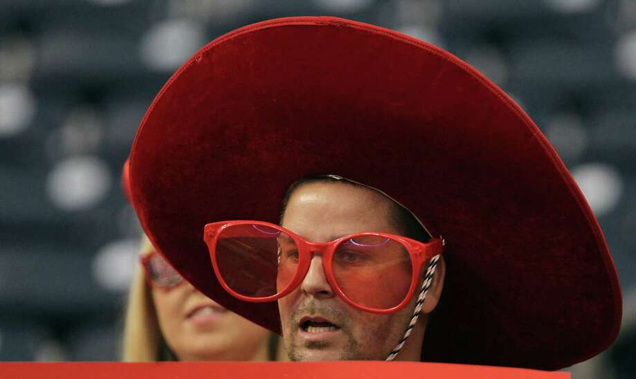 A University of Houston fan during the college football game between Houston Cougars and the South Florida Bulls at Reliant Stadium Thursday, Oct. 31, 2013, in Houston. Photo: James Nielsen, Houston Chronicle / © 2013  Houston Chronicle