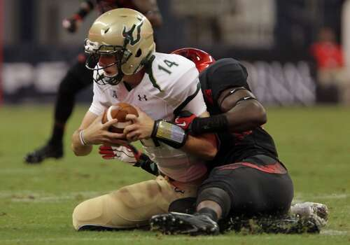 Oct. 26: UH 35, USF 23Record: 7-1  South Florida quarterback Mike White, left, is tackled by Houston linebacker Derrick Mathews during the second quarter of an NCAA college football game Thursday, Oct. 31, 2013, in Houston. (AP Photo/Houston Chronicle, James Nielsen) MANDATORY CREDIT Photo: James Nielsen, Associated Press