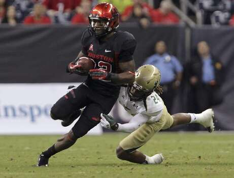 South Florida defensive back Johnny Ward, right, tackles Houston running back Ryan Jackson during the second quarter of an NCAA college football game Thursday, Oct. 31, 2013, in Houston. (AP Photo/Houston Chronicle, James Nielsen) MANDATORY CREDIT Photo: James Nielsen, Associated Press