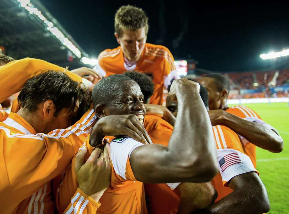 Houston Dynamo midfielder Boniek Garcia joins his teammates congratulate forward Will Bruin after his second goal of the match, in the 72nd minute, against the Montreal Impact on Thursday night at BBVA Compass Stadium. Bruin also scored in the ninth minute as the team advanced in the playoffs.  Garcia added a goal in the 27th minute. Photo: Smiley N. Pool, Houston Chronicle / © 2013  Houston Chronicle