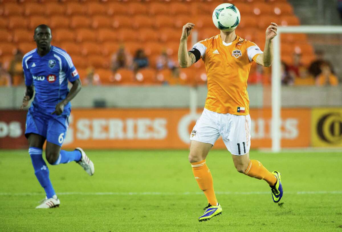 Dynamo midfielder Brad Davis controls the ball during the first half on Halloween night.