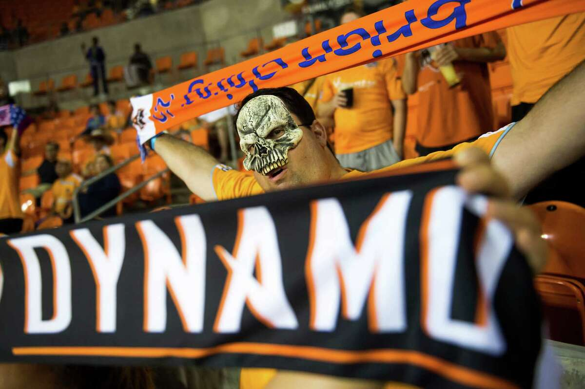Dynamo fans cheer as their team takes the field on Halloween night.