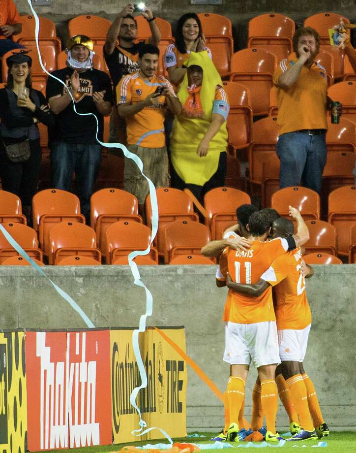 Dynamo fans an players celebrate a goal by Will Bruin during the first half. Photo: Smiley N. Pool, Houston Chronicle / © 2013  Houston Chronicle