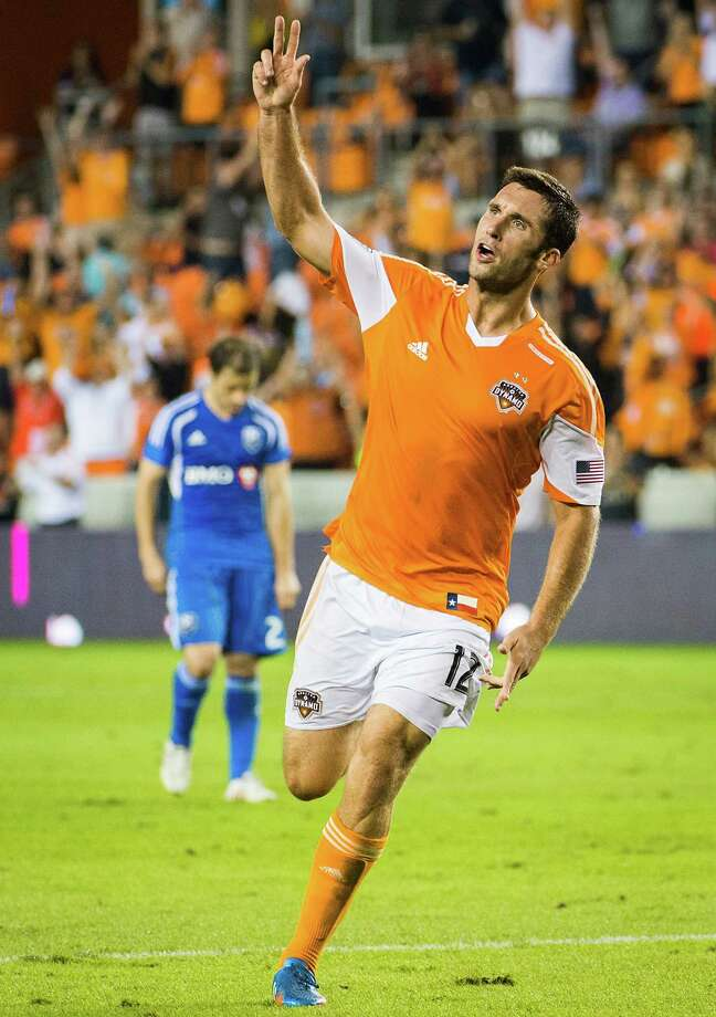 Dynamo forward Will Bruin holds up two fingers as he celebrates after scoring in the 72nd minute for his second goal of the game. Photo: Smiley N. Pool, Houston Chronicle / © 2013  Houston Chronicle