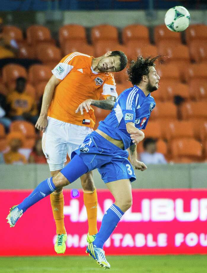 Dynamo defender Eric Brunner fights for a header against Montreal forward Daniele Paponi. Photo: Smiley N. Pool, Houston Chronicle / © 2013  Houston Chronicle