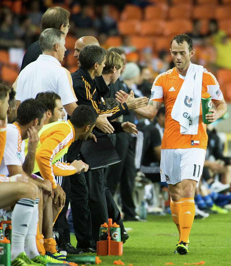 Dynamo midfielder Brad Davis gets a hand as he leaves the game during the second half. Photo: Smiley N. Pool, Houston Chronicle / © 2013  Houston Chronicle