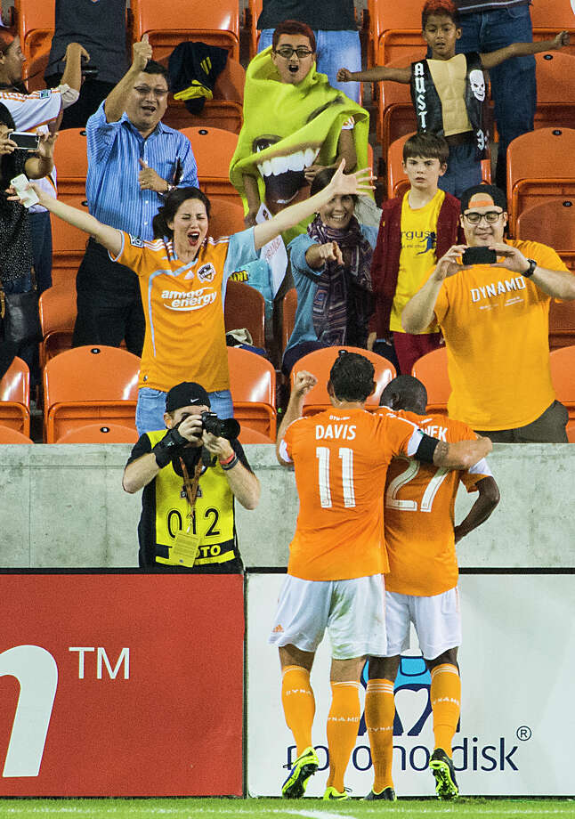 Dynamo midfielder Brad Davis (11) celebrates with Boniek Garcia (27) after Garcia scored on a penalty kick during the first half. Photo: Smiley N. Pool, Houston Chronicle / © 2013  Houston Chronicle