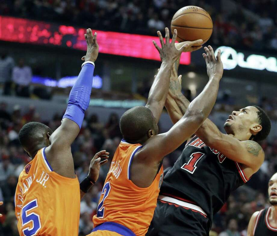 Bulls guard Derrick Rose (right) wore strips of black tape on either side of his sore neck in a game in which he shot 7 of 23 against New York. Photo: Associated Press